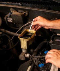Man uses brake fluid tester strip
