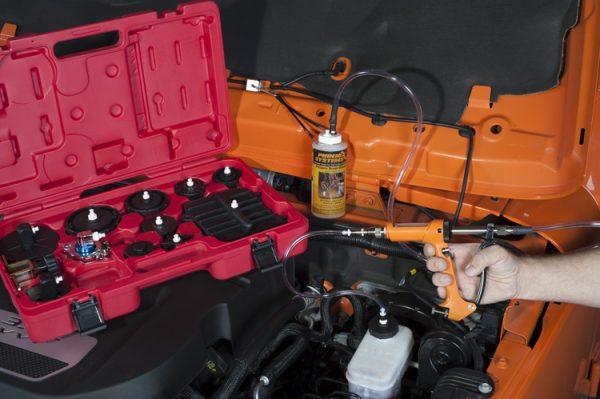 Reverse brake bleeder tool in use