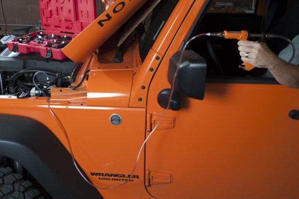 XL brake fluid flush hose and car brake bleeding kit in action