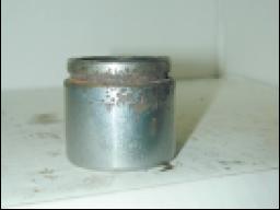 Caliper piston with corrosion