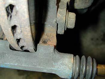 End of pad experiencing wear is binding in bracket or knuckle