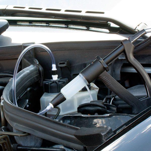 V-12 European car brake bleeding kit attached to master cylinder