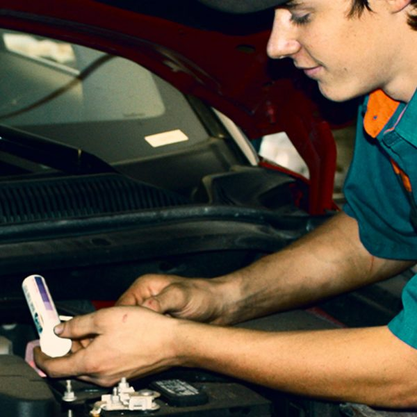 Auto mechanic tests brake fluid contamination and corrosion